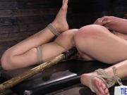 BDSM slave restrained and punished by her rough master