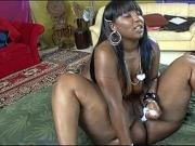 Two busty ebony babes drench one another in oil