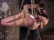 Hogtied brunette in different rope bondage positions