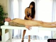 Big tits masseuse gives a nice footjob under the table