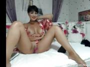 Sensual Black Haired Cammodel Is Having Fun All By Herself