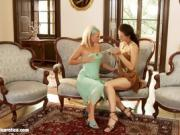 Two Women On Fancy Chair Getting Nude Together