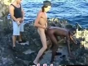 African ebony girl in interracial threesome on seashore