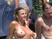 Exibitionist girl getting naked on the beach