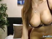 Gorgeous with huge round knockers teases the webcam