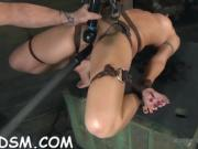Pretty slave bounded with legs spread wide open