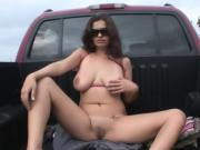 Brunette in sunglasses masturbates in bed of pickup truck
