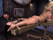 Gagged blonde whipped in bondage