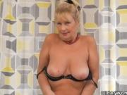 European grandma Gigi teases us with a slow striptease