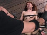 Redhead slave suffers back arch torment