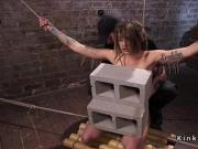 Hot slave in ropes pussy fucked with dildo