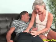 Mature granny tugging cock on couch before cumshot