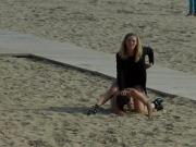 Naked Euro babe disgraced on the beach