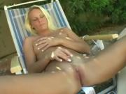 Yanks Blonde Niagra Playing Outside With Her Toy