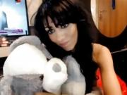 Brunette talks front the webcam and smokes a cigarette