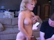 MILF With Big Boobs Lifts Her Legs Up To Get Fucked