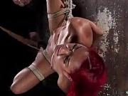 Ebony gets bastinado in hogtie
