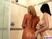 Lesbians Tasha and Keisha team up for some bathroom fun