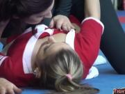 Sapphic cheerleader wrestling on the floor and getting orally