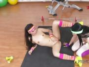 Brunette and Asian lesbians at the gym
