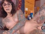 Dirty Tattooed Camgirl And Her Dildo Fuck Machine