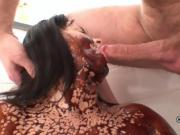 Nasty brunette drenches herself in chocolate sauce