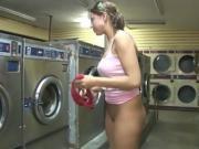 Sexy coed masturbation inside a laundromat