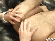 Dirty milf dangles two large cock and balls on her lips