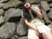 Adorable Asian brunette rubbing her soaking wet cunt