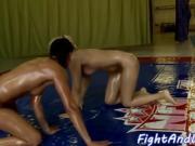 Busty oiledup dyke wrestling her opponent