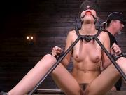 Blonde strapped in metal device bondage