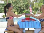 American mom and teen licking in patio