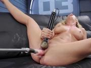 Blonde on machine squirting on the couch