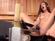 Shaved solo brunette fucks machine