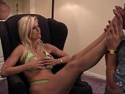 Gorgeous blonde with big tits uses her feet to wank him off
