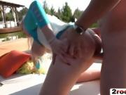 Slutty girlfriends get fucked outdoors by the lake