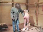 Shibari master plays with his slave