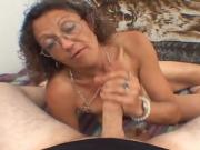 Old cougar plays with her pussy and sucks a dick