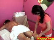 Bigtitted asian masseuse tugging client cock