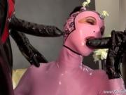 Three beauties in rubber play together on camera