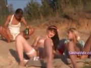 Girls party with bottles on the beach