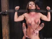 Busty brunette fingered in device bondage