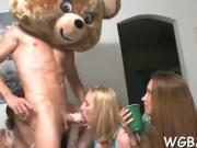 Horny stripper is getting his pecker sucked by several babes