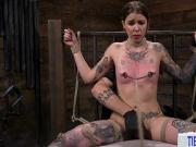 Tattooed young submissive punished in dark sex dungeon