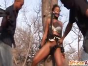 Black MILF tied to a tree flogged and forced to take cock