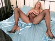 Horny blonde vigorously fucks toy in seamless nylon pantyhose