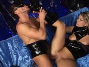 Kinky couple dresses one another in rubber