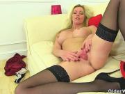 English milf Holly Kiss slides a finger up her fanny