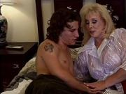 Busty blonde cougar handles a cock with experienced hands