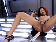 Inked ebony babe rubs pussy before dildo machine toying